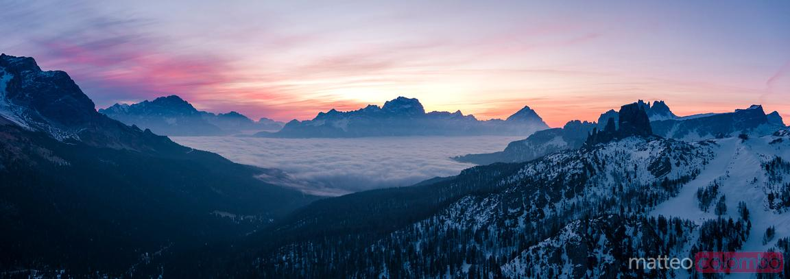 Aerial view of sunrise over mountains with low clouds