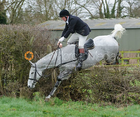 Dick Wise jumping the first hedge