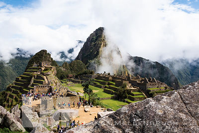 Machu Picchu in the morning as tourists are winding there way through the points of interest