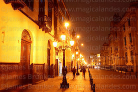 View along Jiron Carabaya towards Plaza de Armas at night, Lima, Peru