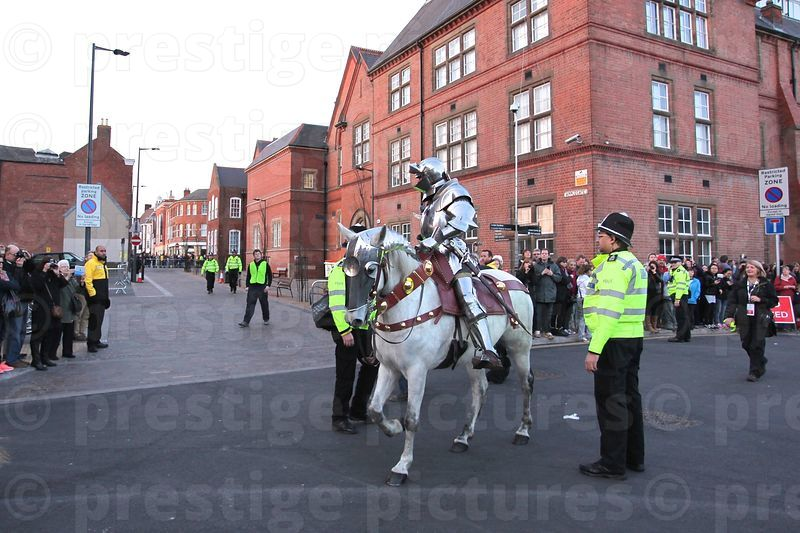 Armour Clad Knight on a White Charger Heading up the retreating Cortege