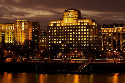 Shell Mex House at Sunset with Lights Reflecting in the River Thams