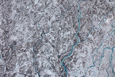 Aerial view of meltwater channels in ice cap north-east of Sermeq Kujalleq Glacier, Sermersuaq / Greenland ice sheet, Greenla...