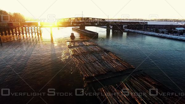 Tugboat Pulling Log Booms up the Fraser River at New Westminster BC