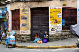 Women sitting in doorway selling items, Tarija, Bolivia