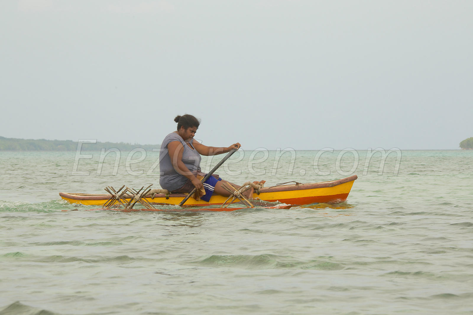 Fisherwoman on a canoe Santo