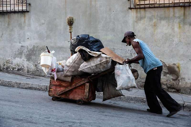 Portrait of a Man Collecting Trash in the Street