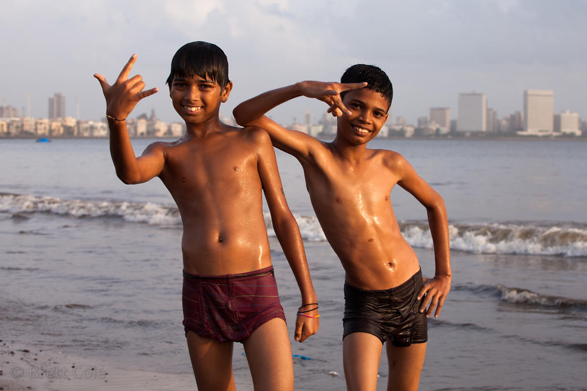 Two boys play in the Arabian Sea at Back Bay, Chowpatty Beach, Mumbai, India.