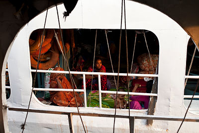 Bangladesh - Dhaka - A woman and her family aboard a ferry moored in Sadarghat