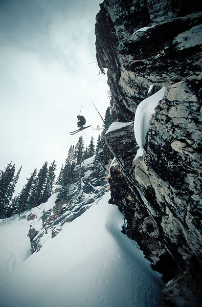 Skier jumping a cliff in Albion Basin, Alta, Utah