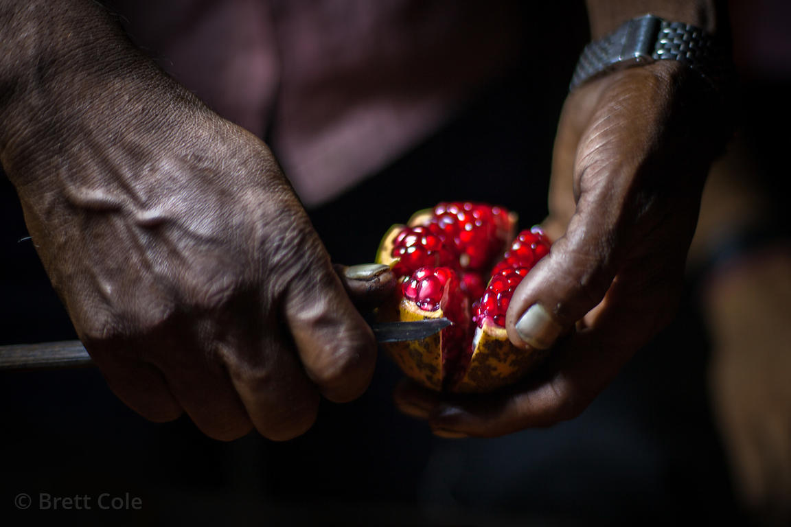 A man cuts a pomegranate at a market in Kokri Agar slum, Kolkata, India.