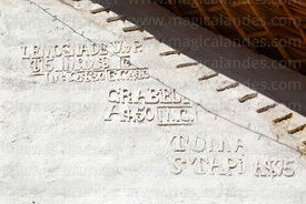 Names of donors of construction funds carved on entrance facade of St Peter / San Pedro church, Guañacagua, Region XV, Chile