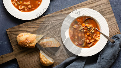 Close-up of two bowls of Minestrone soup.