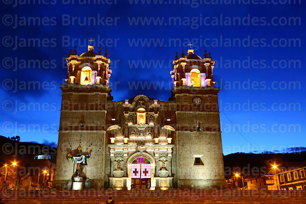 Cathedral entrance facade lit up after sunset, Plaza de Armas, Puno, Peru