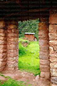 View through doorway in Inca site of Huchuy Qosqo, Cusco Region, Peru