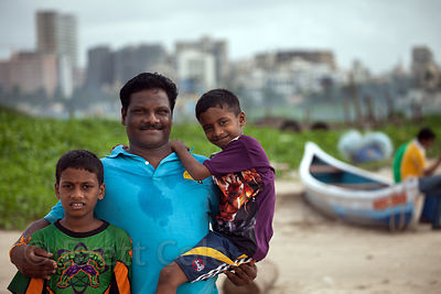 Portrait of a family on Chowpatty Beach, Mumbai, India.