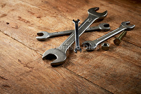 Jumble of mouth wrenches diagonally scattered on a wooden background