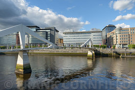 SCOTLAND - GLASGOW, JULY 21, 2017:  The Tradeston Bridge, also know as the Squiggly Bridge crosses the river Clyde connecting...