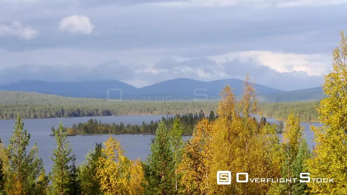 Autumn Color Landscape, Time Lapse of Autumn Trees, a Lake and Fjeld Tunturi Mountains, on a Sunny and Rainy Fall Day, in Sar...