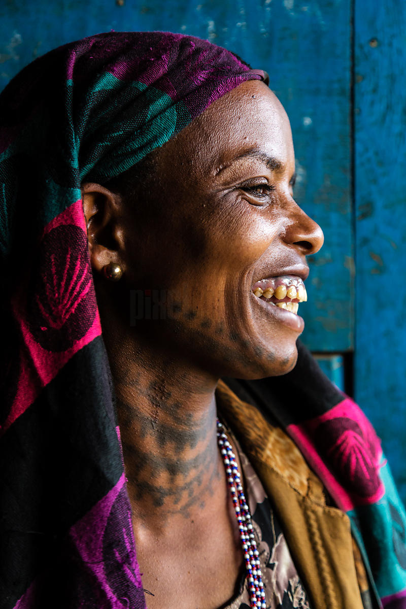 Portrait of a Smiling Woman with a Tatooed Neck