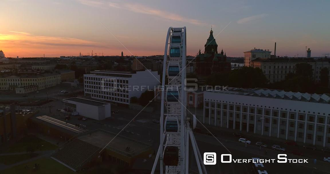 Sunset City, Aerial View Around the Helsinki Skywheel Ferris Wheel, Revealing the Market Square and South Harbour, on a Sunny...