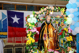 Statue of St Paul and national flag at St Paul festival, Arica, Chile