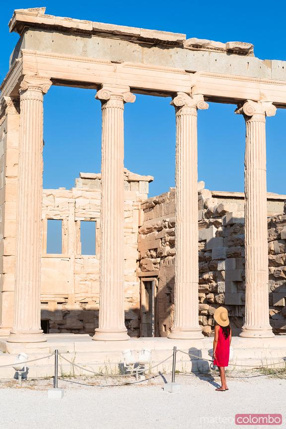 Woman looking at a temple on the Acropolis, Athens, Greece