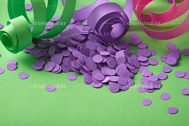 Carnival background with purple confetti and serpentines on green background horizontal