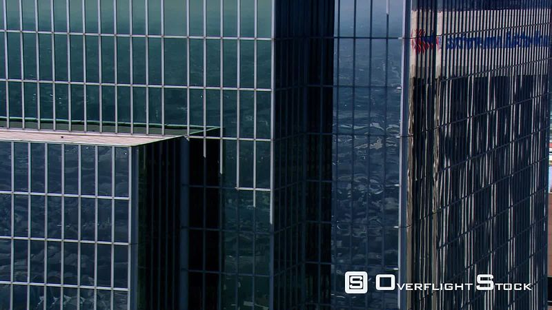 Close flight near skyscraper's frame-filling glass grid