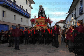 Devotees with figure of Virgen Dolorosa during Good Friday procession , Cusco , Peru
