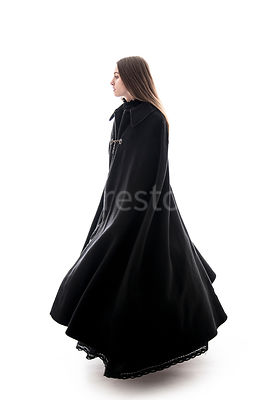 A woman in a big cloak walking – shot from low level.