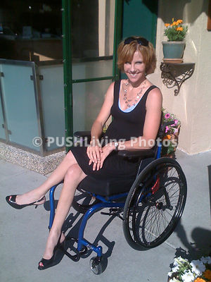 Woman in wheelchair on patio