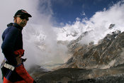 Mountaineer in front of open landscape