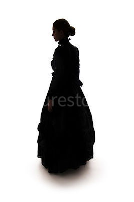 A Victorian woman, standing, in a dress, in silhouette – shot from eye level.