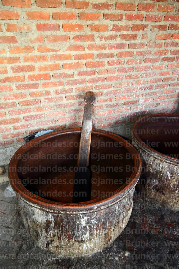 Ceramic pots used for preparing chicha / traditional maize beer and wooden utensil for stiring, Bolivia