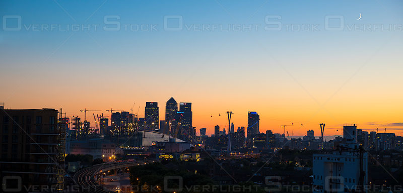 Dusk over Canary Wharf and Tram Railway London England