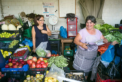 Two women stallholders on their stall at the Mercado do Bolhão, Porto, Portugal
