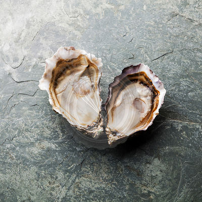 Heart shape Oysters on stone plate background