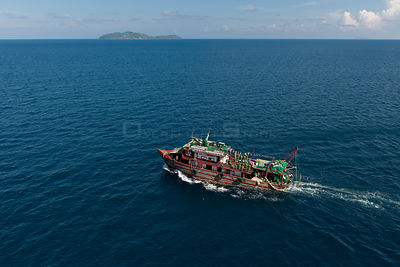 Aerial of a trawler illegally trawling in protected municipal waters, Philippines, May 2009