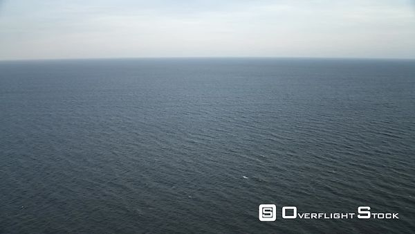Over open ocean off the New Jersey coast, descending from 1000 feet to 100 feet. Shot in November
