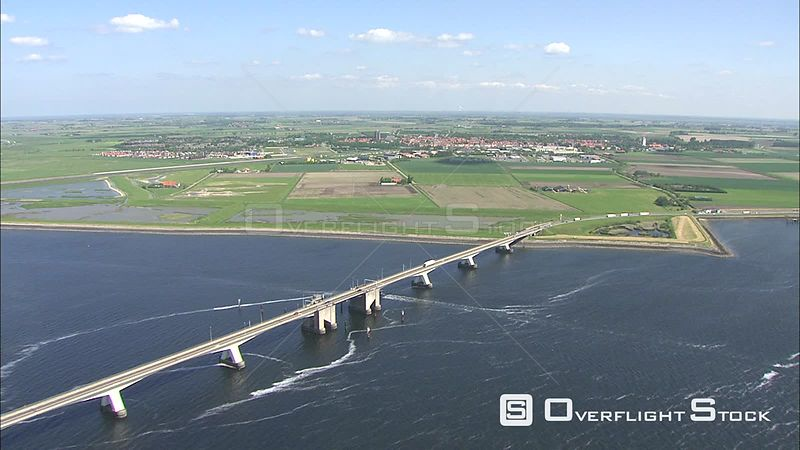 Vehicles crossing and boat passing under Zeeland Bridge, The Netherlands