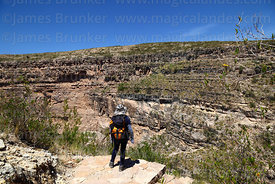 Hiker looking at view of Torotoro Canyon, Torotoro National Park, Bolivia