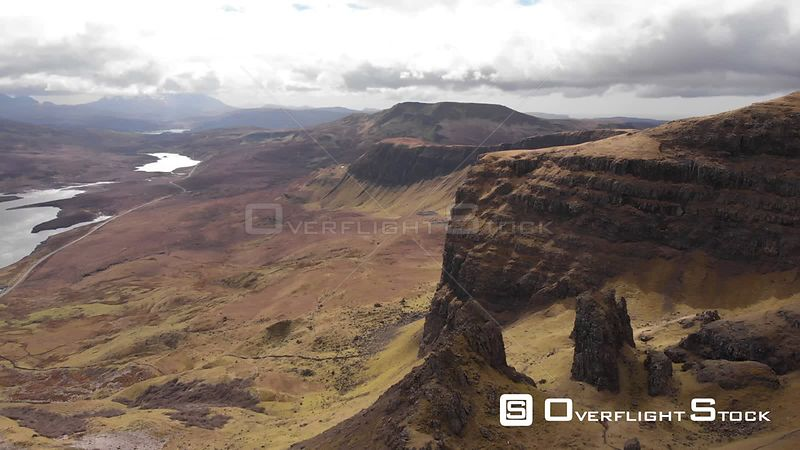 Aerial drone shot of mountains near the Storr on a sunny day, Isle of Skye, Scotland