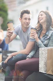 Young couple relaxing with coffee to go