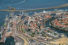 Luchtfoto - Harlingen met Taal Ships in de Haven