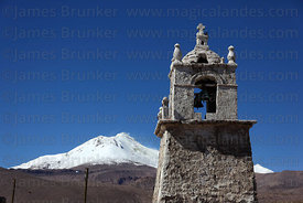 Guallatiri village church bell tower, Guallatiri volcano in background , Las Vicuñas National Reserve , Region XV , Chile