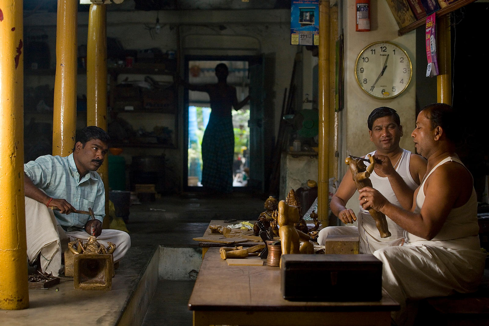 Master craftsmen Radhakhrishna Stpathy and his brother Srikanda mould an icon in wax in their workshop in Swamimalai. The cur...