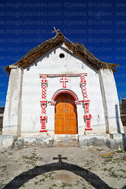 Entrance facade of rustic church in Cotasaya village, Region I, Chile