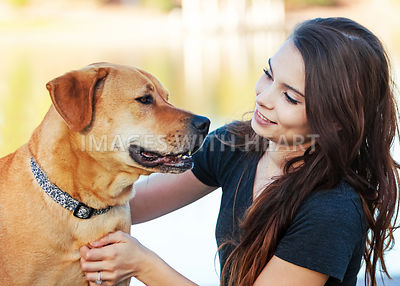 Girl and Dog Interacting Outdoors