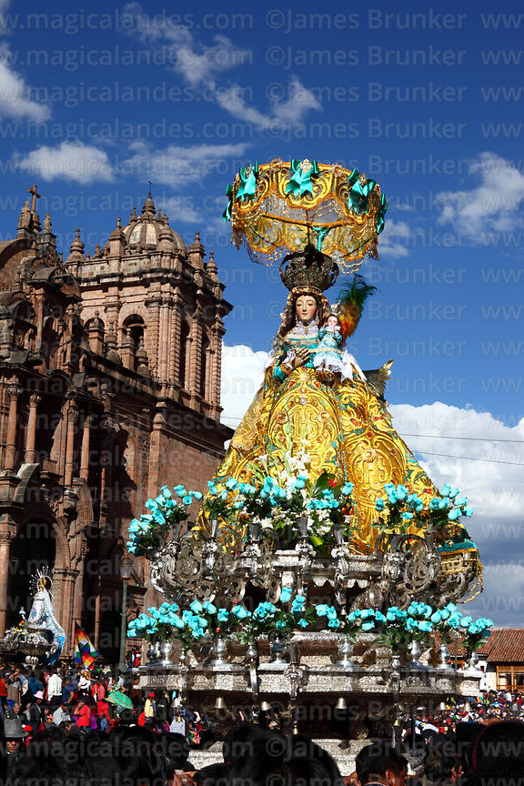 Devotees with Virgen de Belen in front of cathedral during parades for Corpus Christi festival , Plaza de Armas , Cusco , Peru